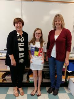 Grace is pictured with her teacher, Debbie MacQueen, and Michelin representative, Linda MacLeod.
